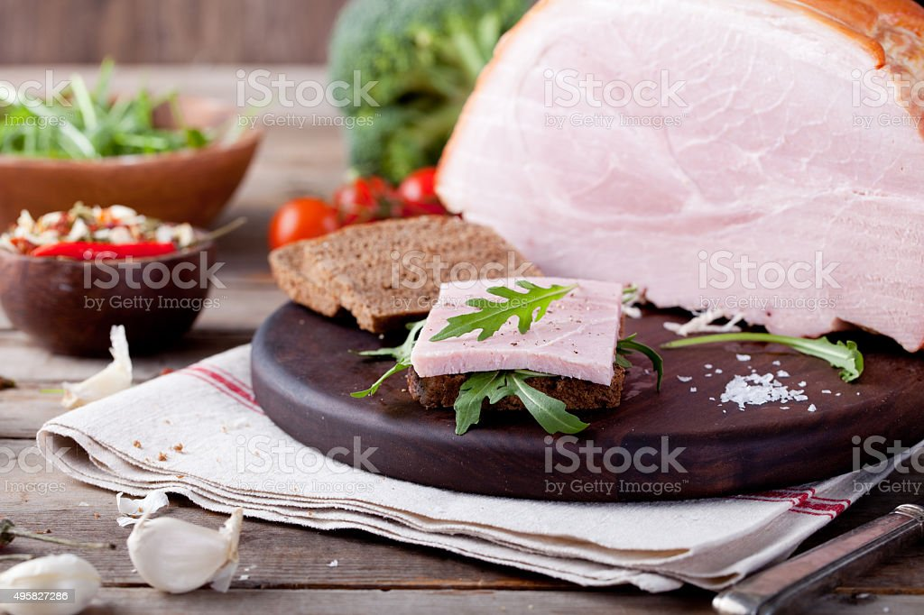 Pork ham with fresh salad and vegetables. stock photo