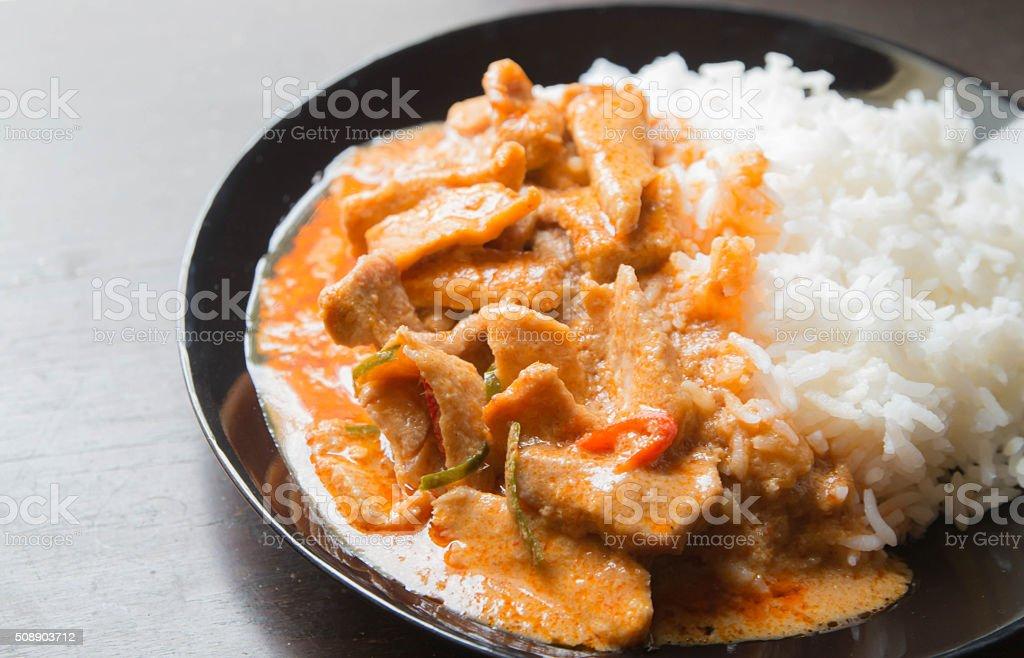 pork in ground peanut-coconut cream curry serve wite rice stock photo