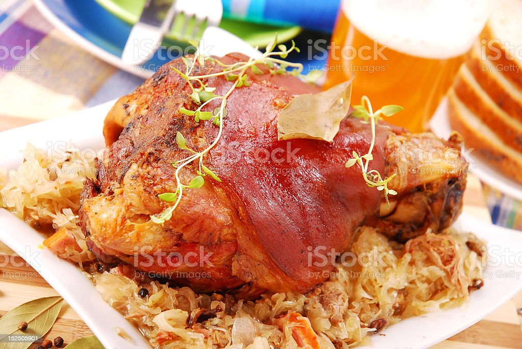 pork knuckle baked with beer stock photo