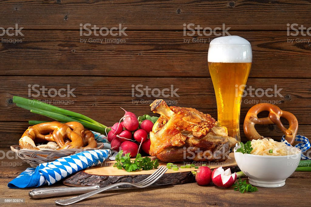 Pork knuckle with beer and sauerkraut stock photo