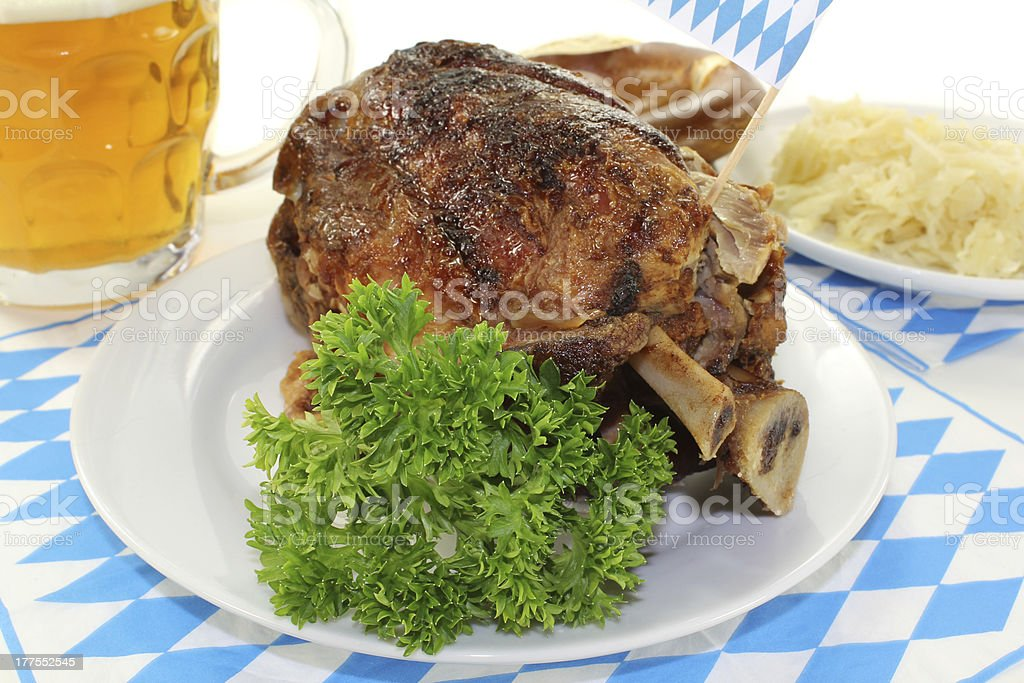 pork knuckle with pretzels stock photo