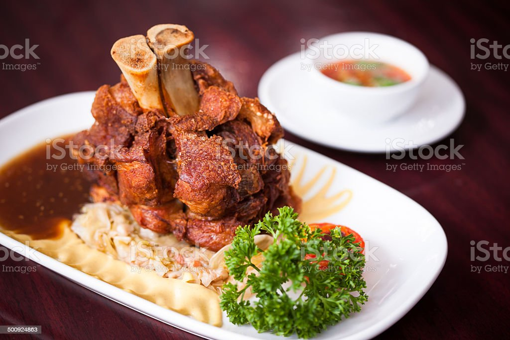 Pork knuckle with vegetables (Schweinshaxe) stock photo