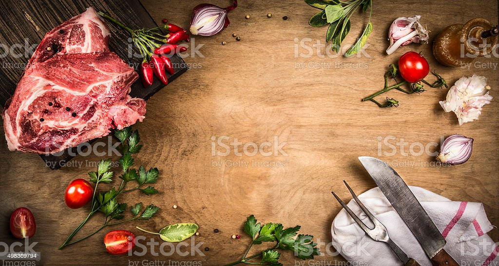 Pork kotelett fresh ingredients cooking herbs,spices and tomatoes. frame stock photo