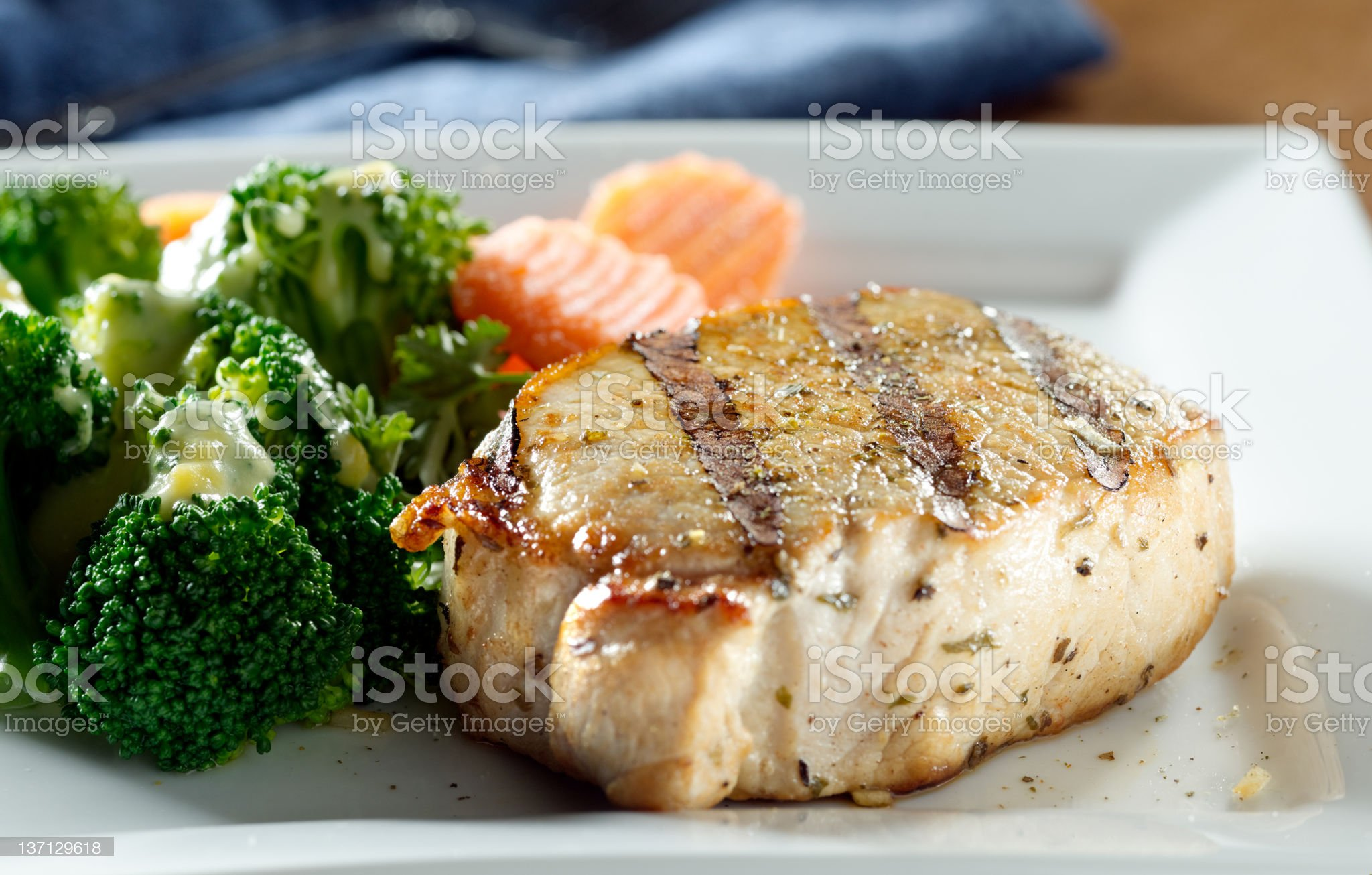 Pork loin filet with carrots, broccoli and hollandaise sauce royalty-free stock photo