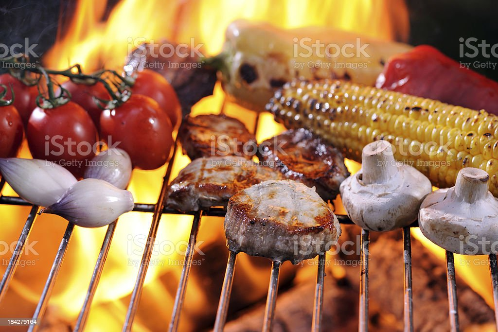 Pork Loin Medallions and Vegetables on Barbecue stock photo
