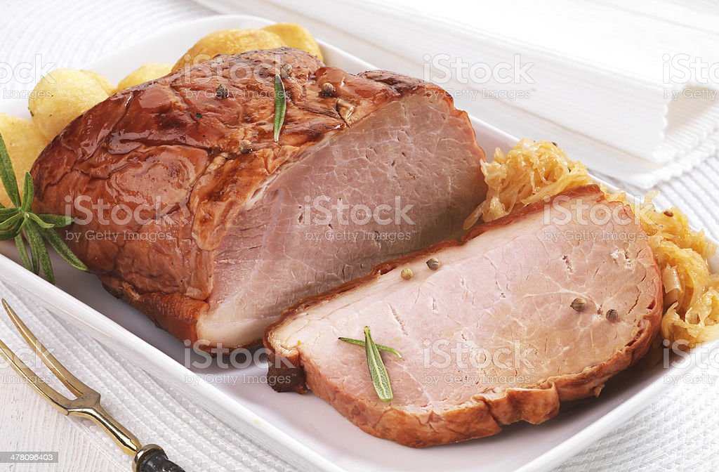 Pork loin on white plate royalty-free stock photo