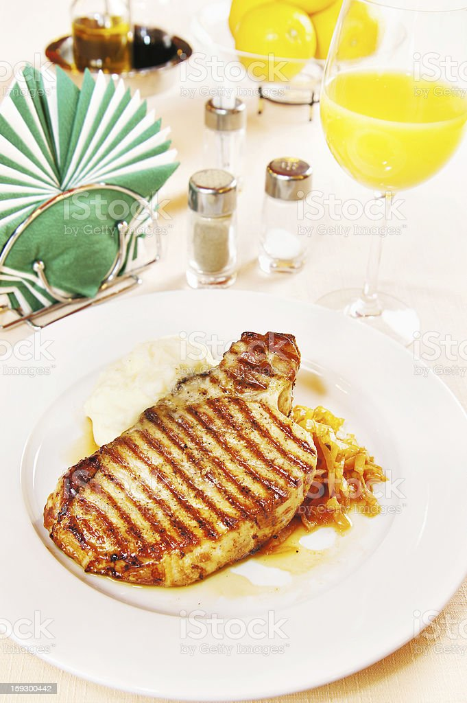 Pork loin with boiled potatoes and sauerkraut royalty-free stock photo