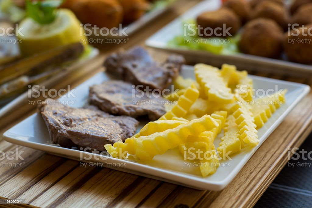 Pork meat and french fries royalty-free stock photo