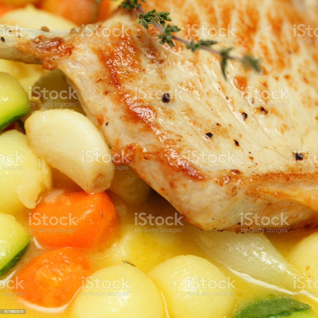 Pork meat and vegetables garnish, gourmet restaurant food stock photo