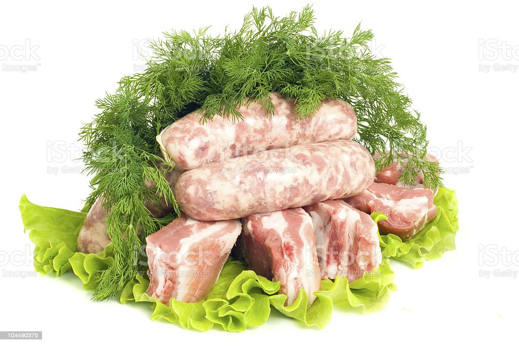 Pork meat, Sausages and dill on green salad royalty-free stock photo