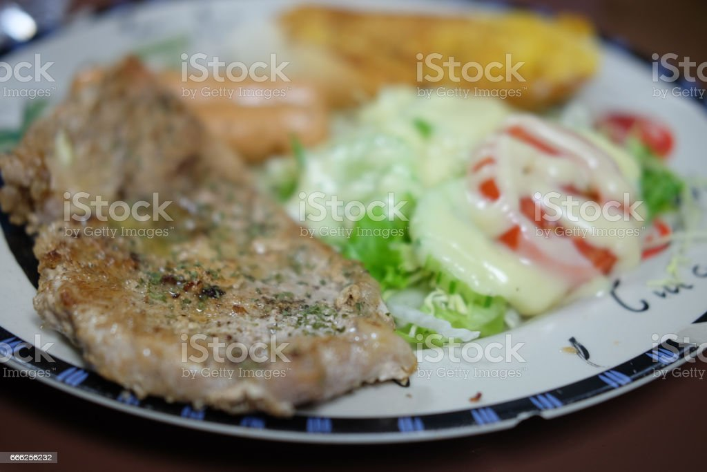 BBQ pork meat steak with salad stock photo