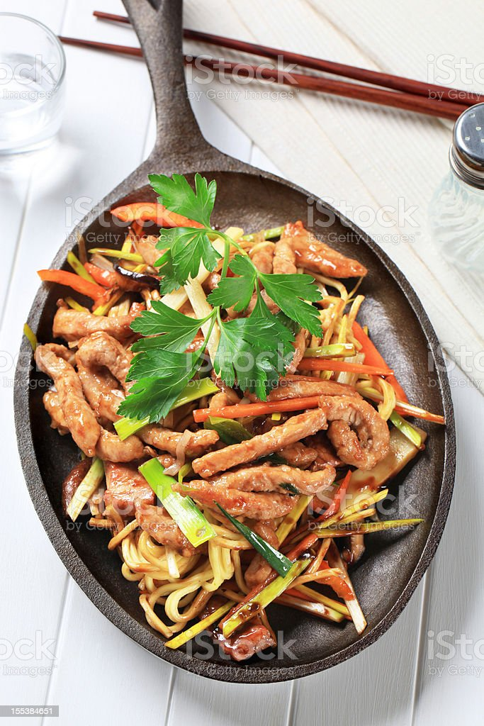 Pork meat stripes with fried vegetables royalty-free stock photo