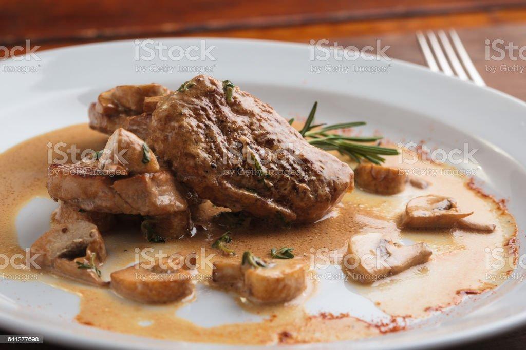 Pork medallions with mushroom sauce stock photo