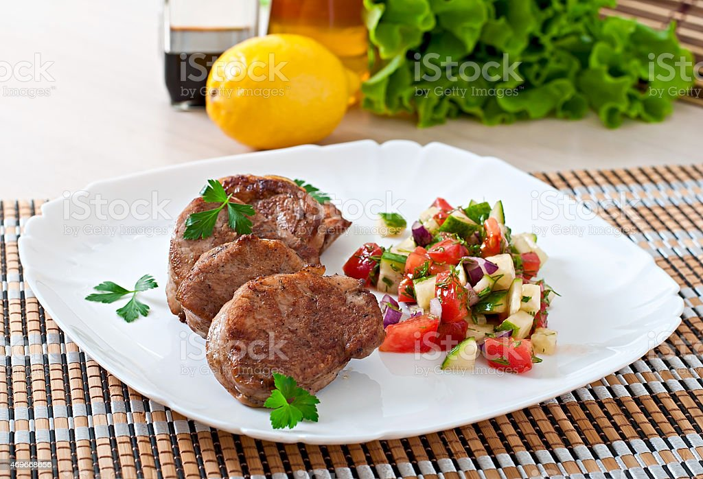 Pork medallions with salsa stock photo