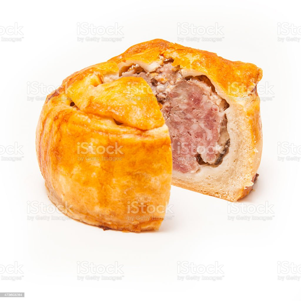 Pork pie isolated on a white studio background. stock photo