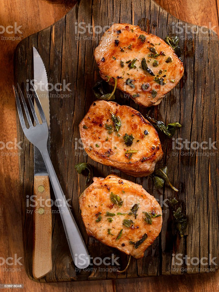 Pork Rib Chops with Fresh Herbs stock photo
