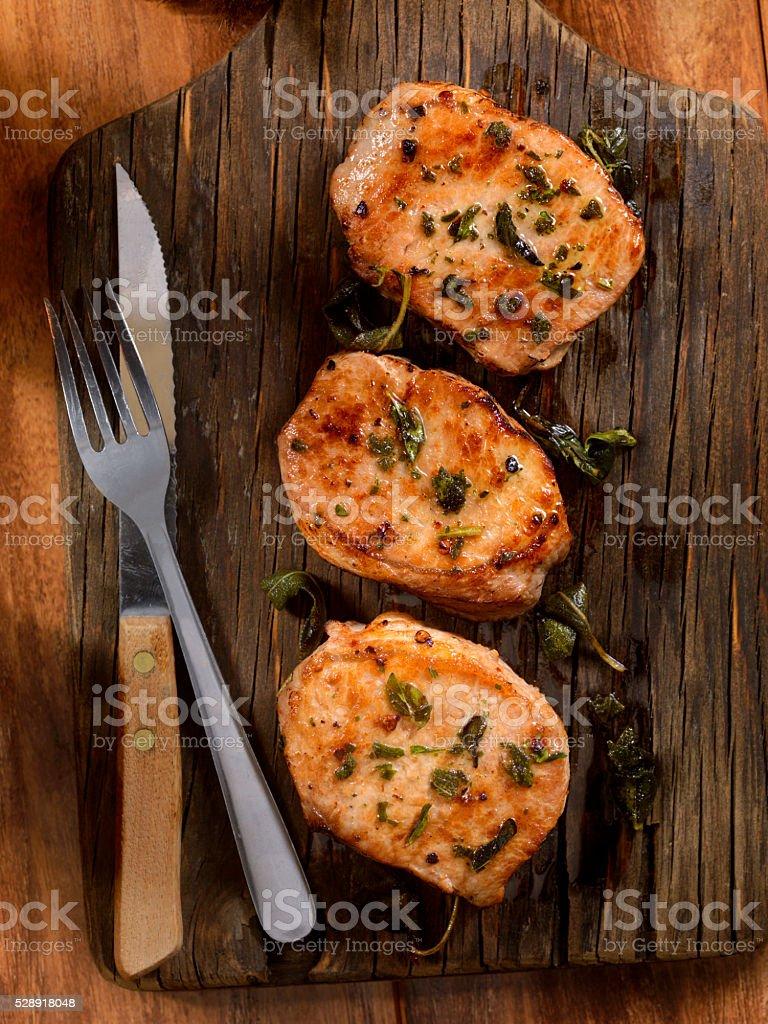 Pork Rib Chops with Fresh Herbs stock photo