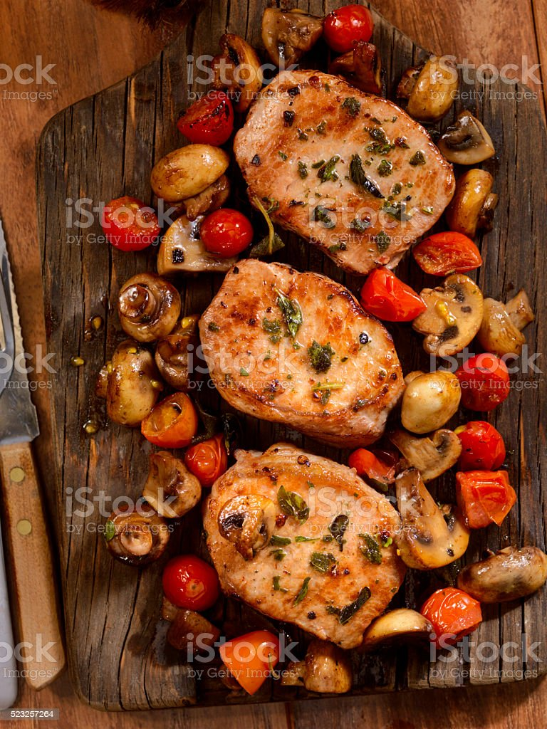 Pork Rib Chops with Tomatoes and Mushrooms stock photo