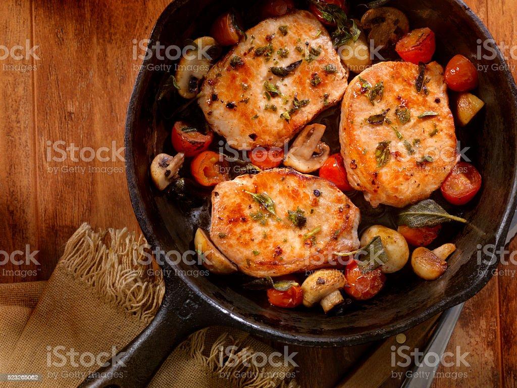 Pork Rib Chops with Tomatoes and Mushrooms stock photo