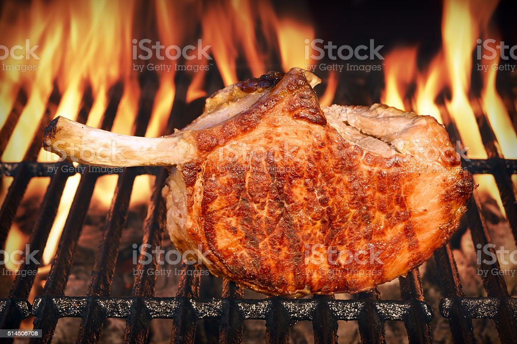 Pork Rib Steak On The Hot Barbecue Flaming Grill stock photo