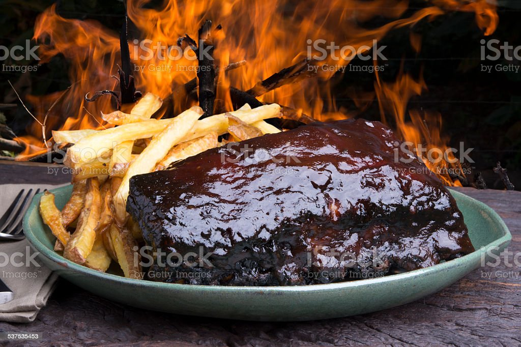 Pork ribs back with french fries stock photo