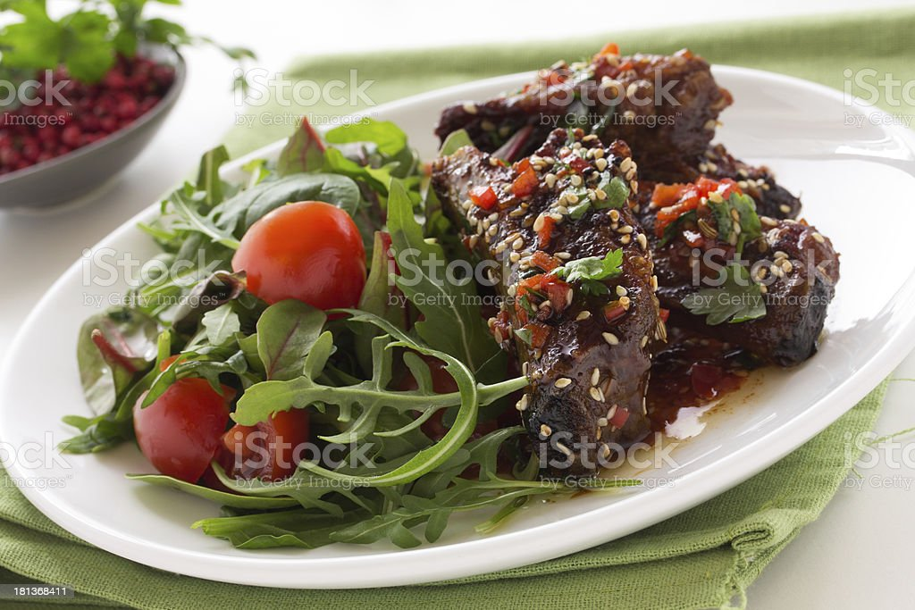 Pork ribs in ginger glaze with salad. stock photo