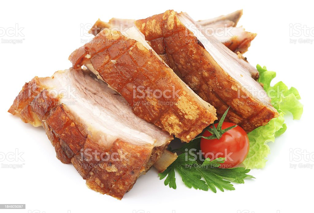 Pork ribs with tomato, salad and parsley isolated on white stock photo