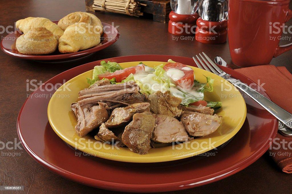 Pork roast and salad royalty-free stock photo