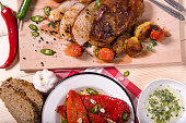 pork roast cuts with  roasted peppers