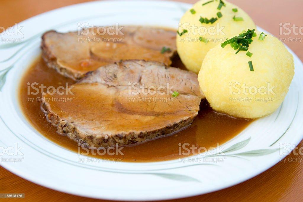 pork roast with dumplings stock photo