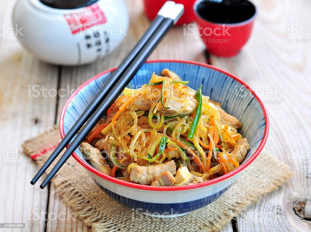 Pork roast with rice noodles, carrots, zucchini, garlic, ginger stock photo