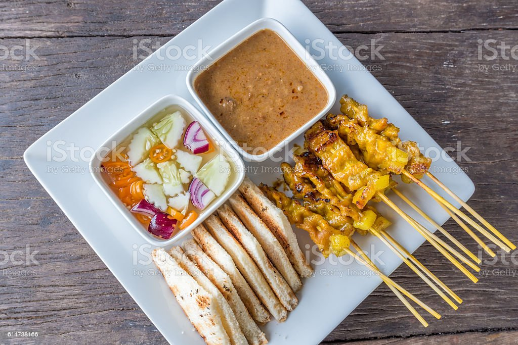 Pork Satay With Thai Spices and Peanut Sauce Recipe stock photo