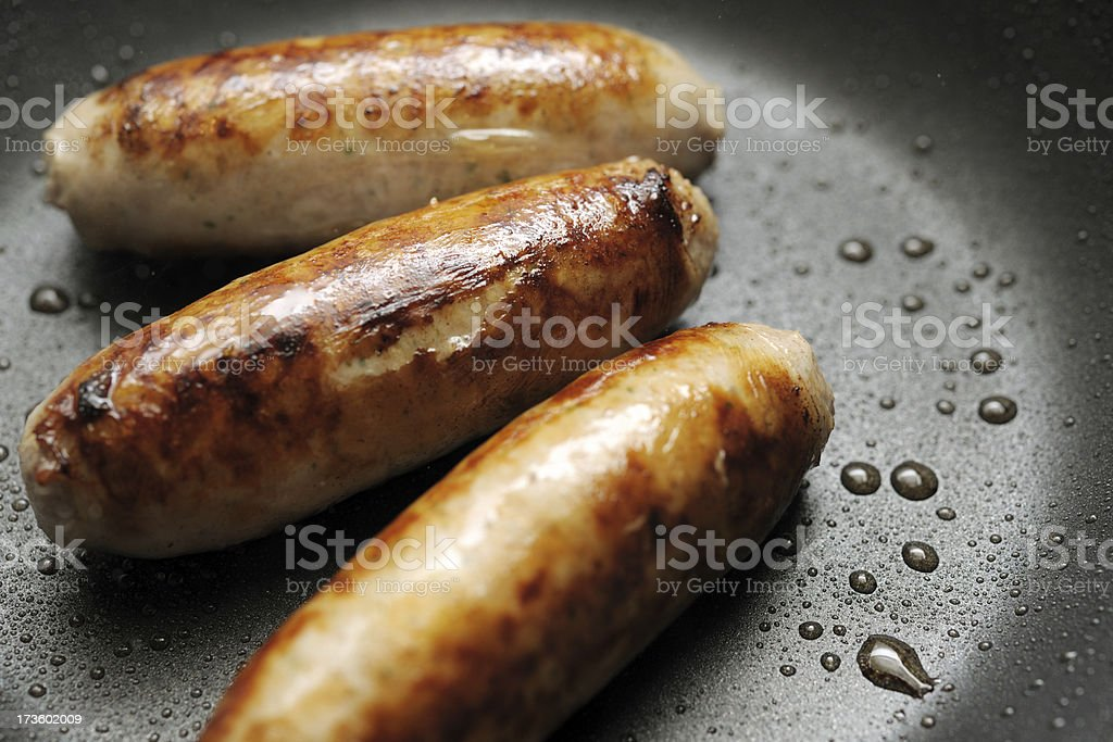 pork sausages in a frying pan (XXXL) royalty-free stock photo