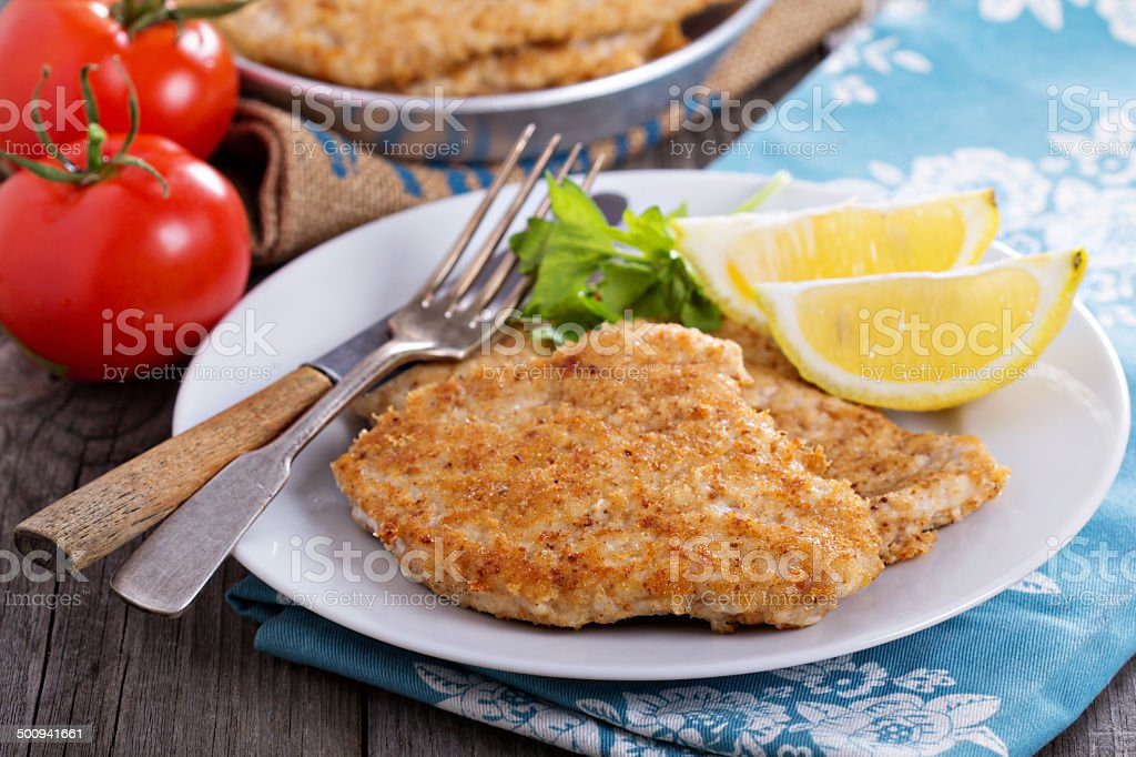 Pork schnitzel with parmesan stock photo