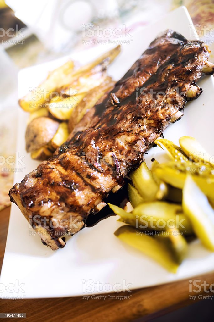 Pork spare ribs with barbecue sauce as main dish stock photo