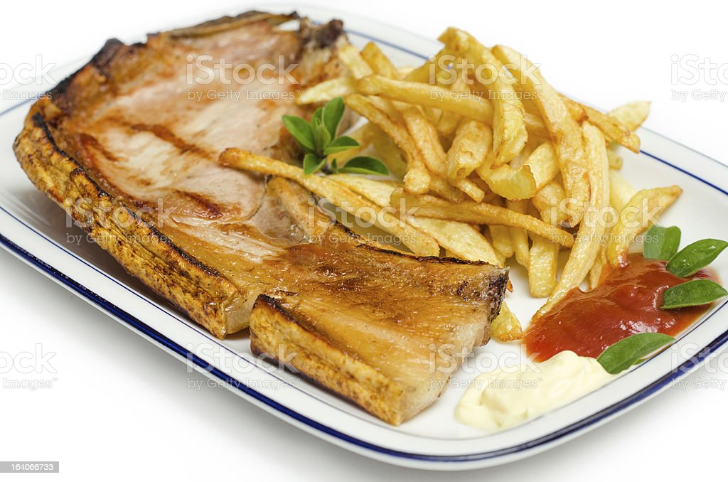 Pork steak and fried chips royalty-free stock photo