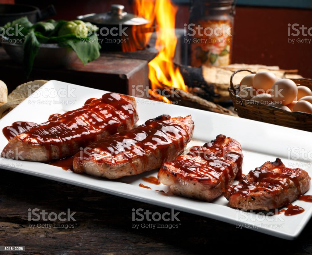 Pork steak with barbecue sauce stock photo