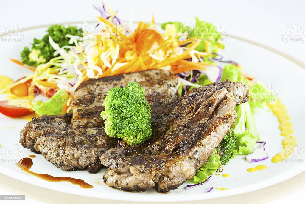 Pork steak with vegetables and gravy royalty-free stock photo