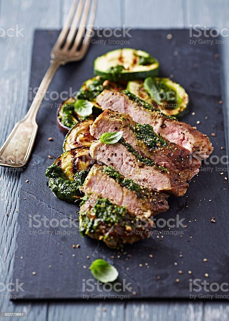 Pork Steak, Zucchini and Aubergine with Salsa Verde stock photo