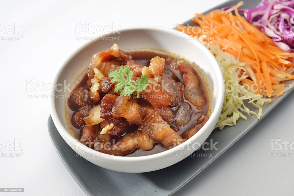 Pork sweet stewed in the sweet brown gravy, Chinese-Thai cuisine stock photo