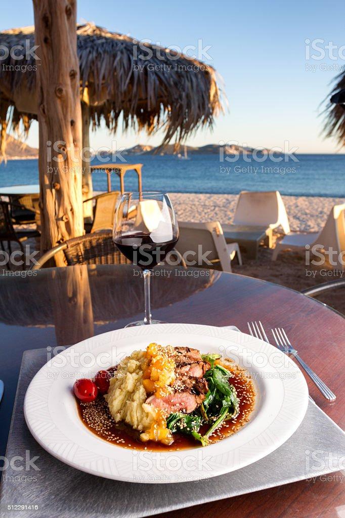 Pork Tenderloin Dinner at Sunset with Red Wine stock photo