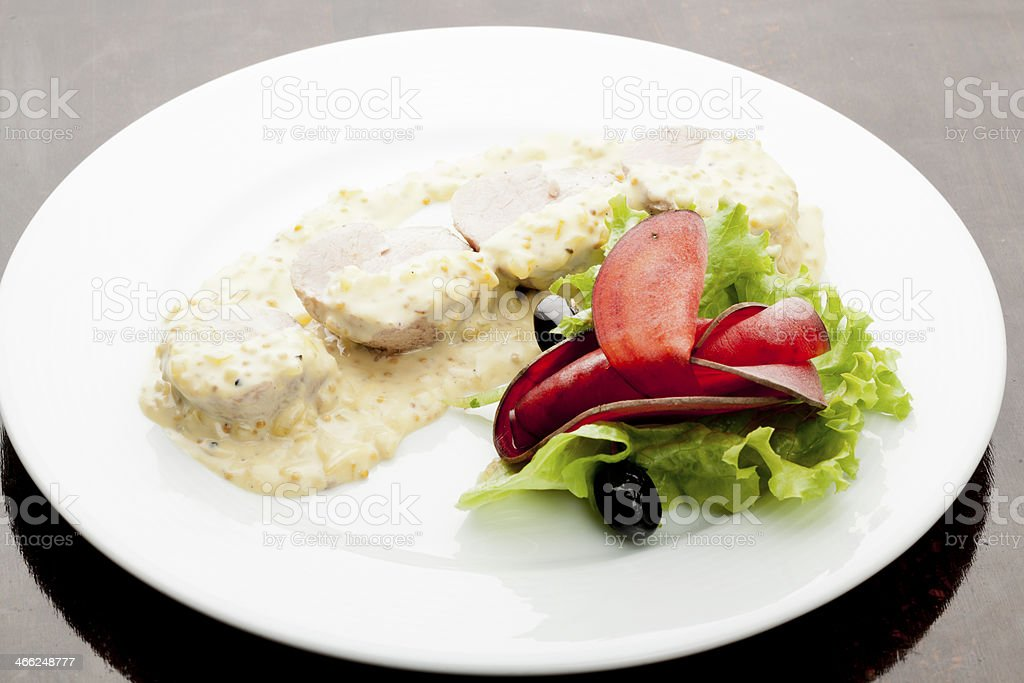 Pork Tenderloin with mustard sauce stock photo