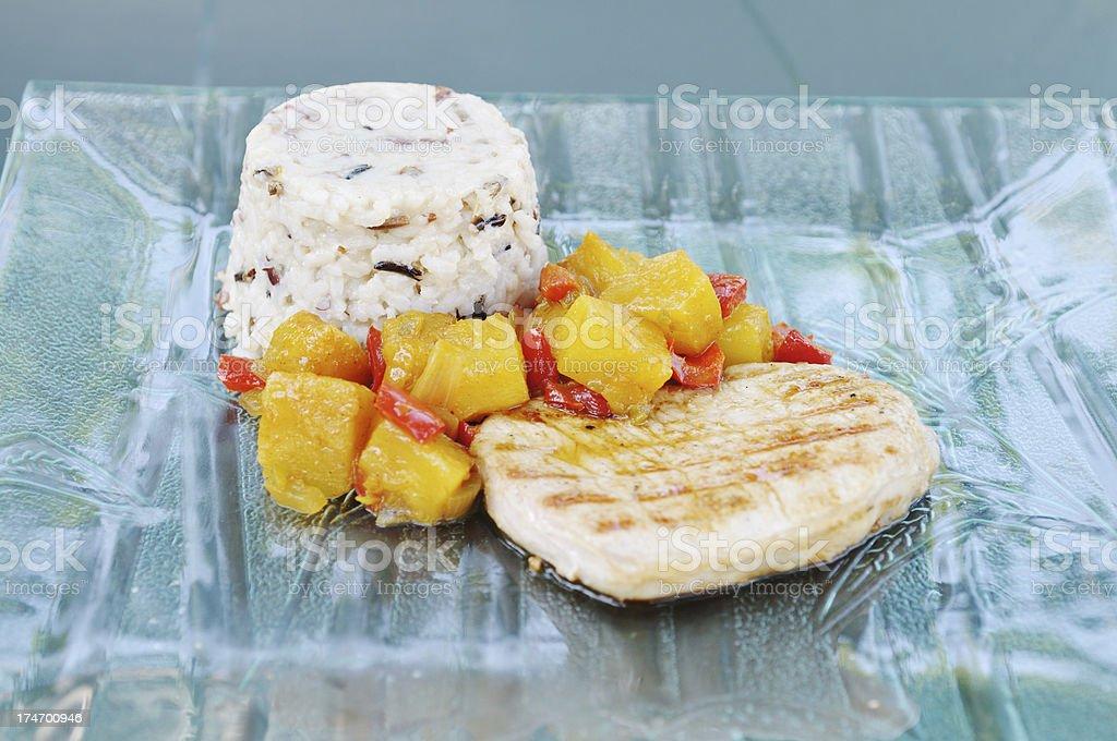 pork with curried pineapple chutney stock photo