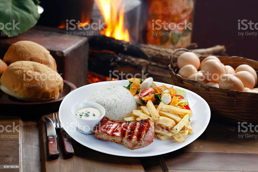 pork with rice and potatoes stock photo