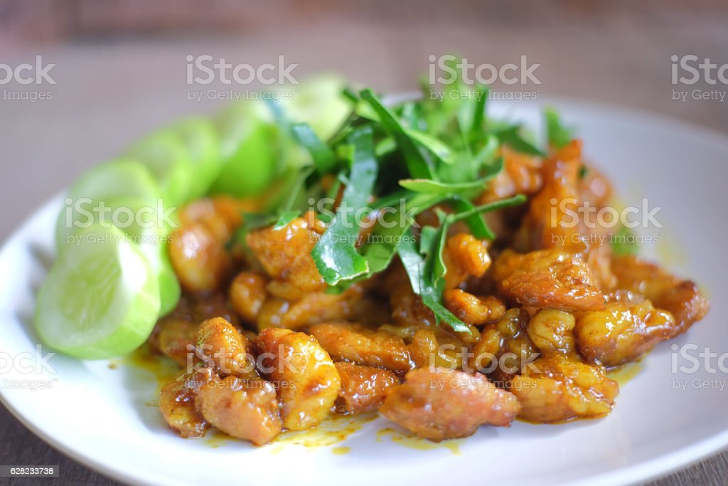 Pork with yellow curry paste stock photo