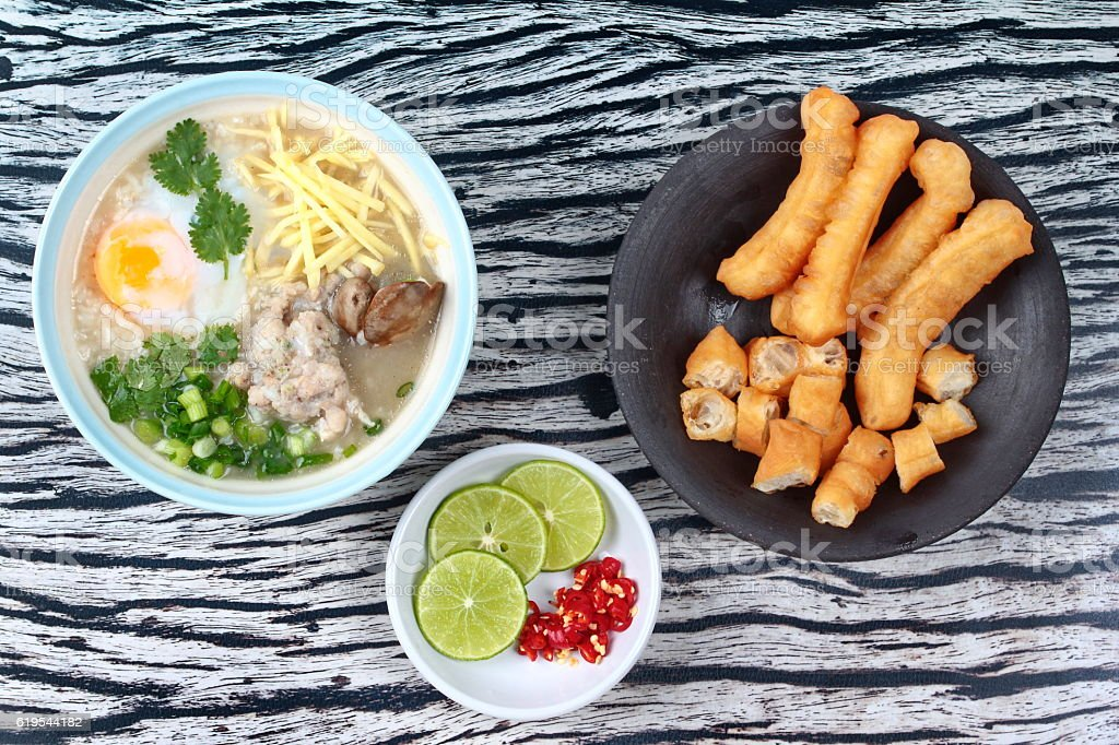 Pork's Rice porridge served with side dish. stock photo