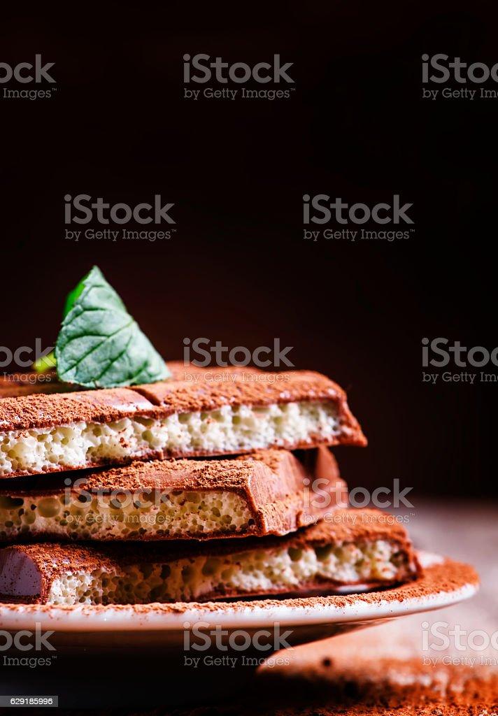 Porous milk chocolate stock photo