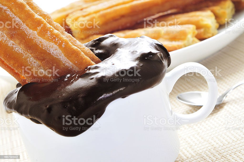 porras, thick churros typical of Spain, dipped in hot chocolate stock photo
