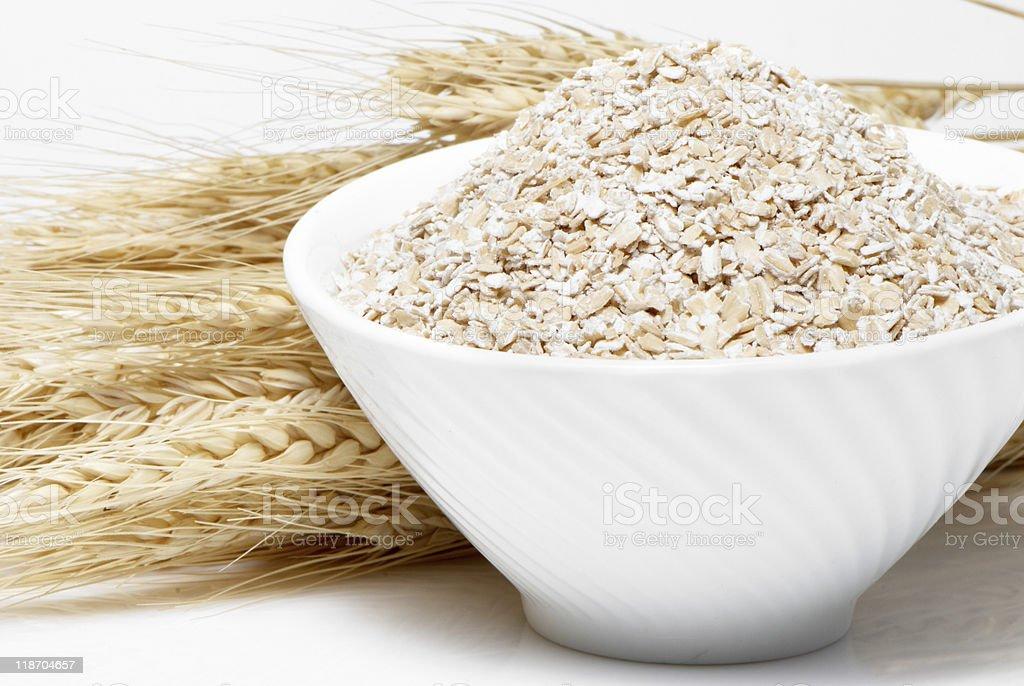 Porridge and Wheat ears on a white background stock photo