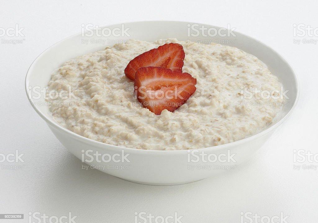 Porridge oats bowl with strawberry stock photo